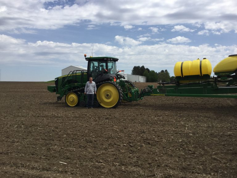 Standing in front tractor on Traer, Iowa Farm | Liqui-grow