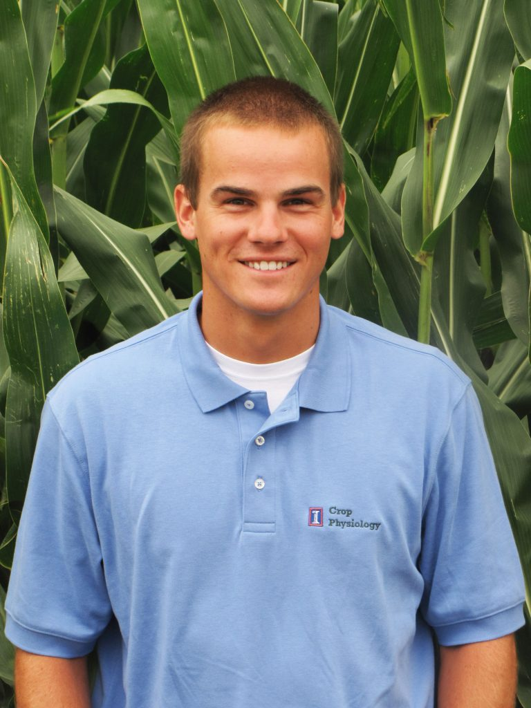 Brad Bernhard standing in front of a corn field